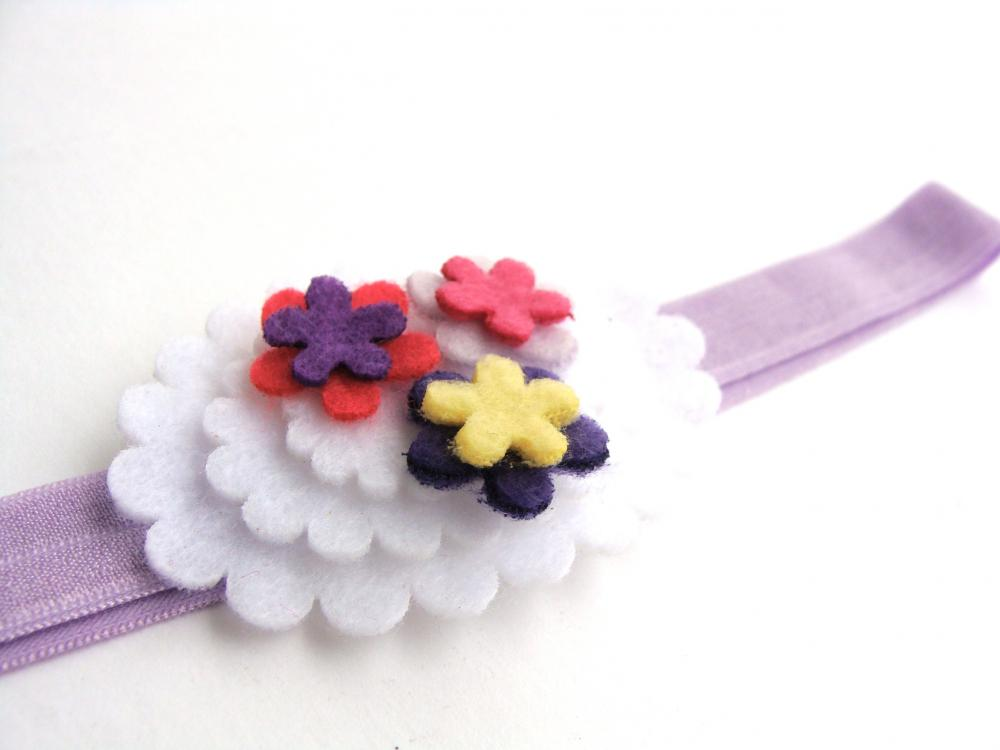 Big girl elastic headband with large oval applique and tiny flowers in soft colors