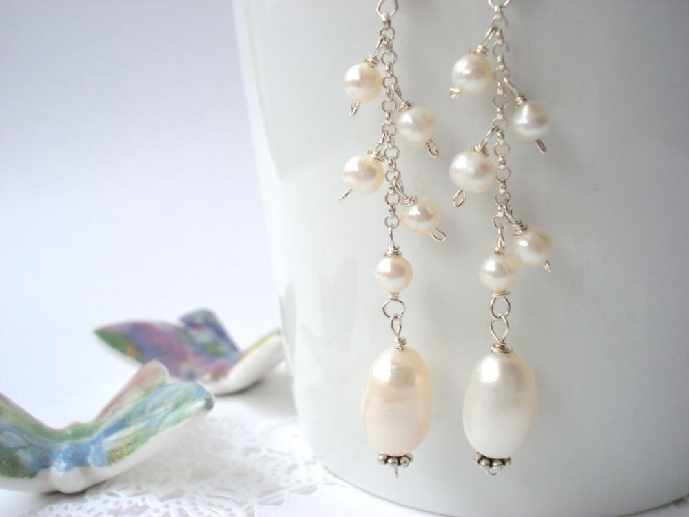Long white freshwater pearl earrings with sterling silver chain.